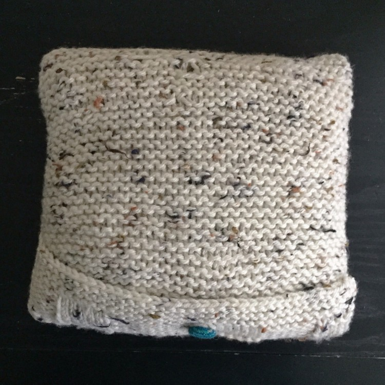Basket weave knitted cushion