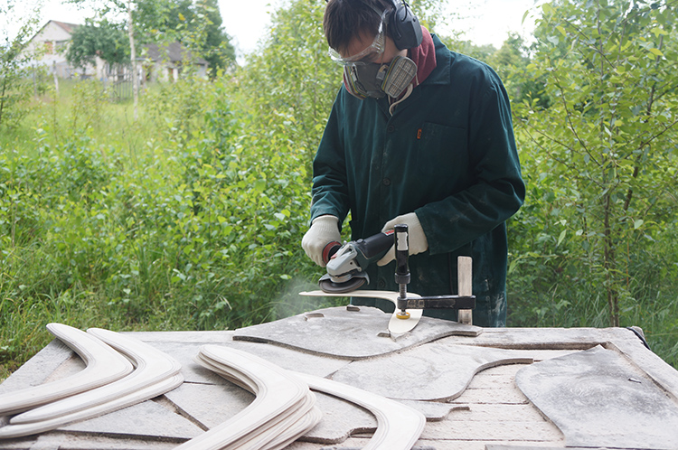 Man Crafts: Sanding handmade boomerangs