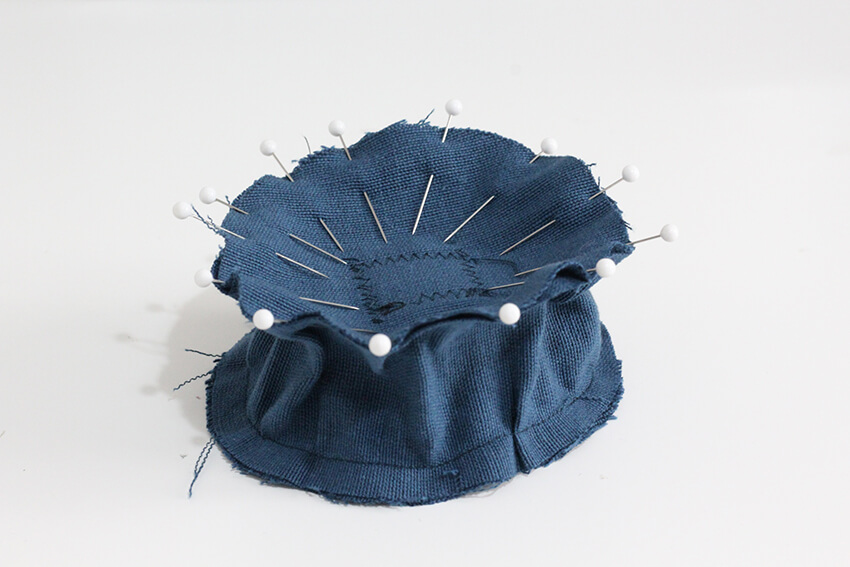 Sew a DIY wrist pincushion that sharpens your needles with wire wool, as you use it